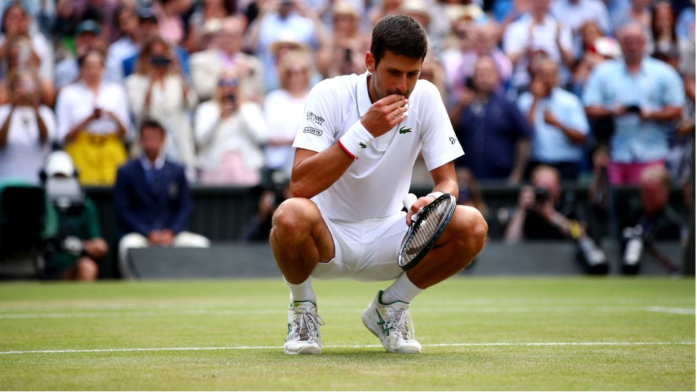 Djokovic just celebrated his Wimbledon win by eating a handful of grass.  Here's why - CNN
